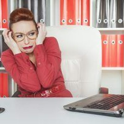 Frustrated, business woman stressing out over business planning and accounting by bizhippo in houston texas.