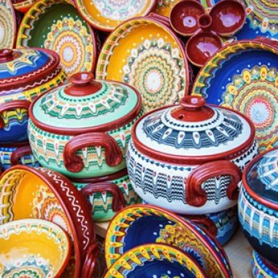 Colorful ceramic dishes. Traditional bugarian patterns.